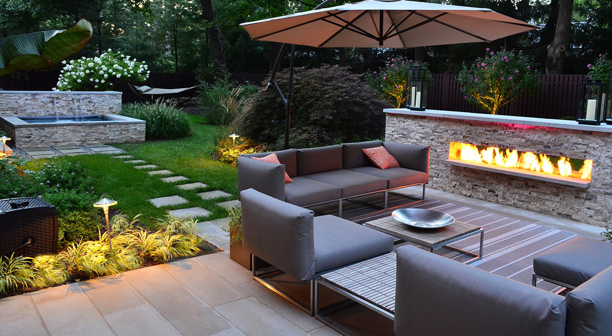 garden-inspiring-garden-landscaping-design-for-backyard-decoration-with-wall-fireplace-stone-wall-decoration-and-brown-couple-coach-exciting-landscape-garden-for-backyard-decoration-e1393039759150
